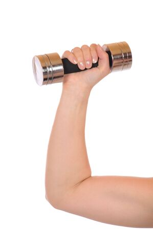 arm up: Young woman with weights in front of a white background Stock Photo