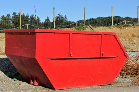 contruction: Red rubble container for road contruction