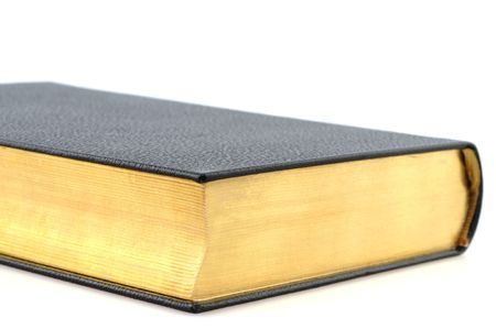 brim: An old book with gold brim on white background