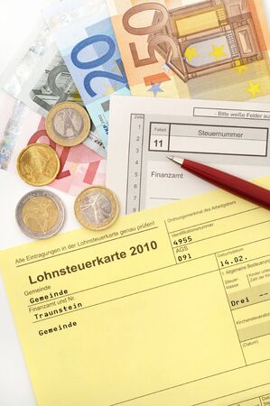 ballpen: German Income tax card 2010 with ballpen and Euro money