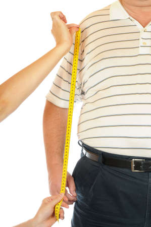 pot belly: Tape measure at a very thick man  Stock Photo