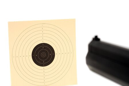 A pistol in direction of a target photo