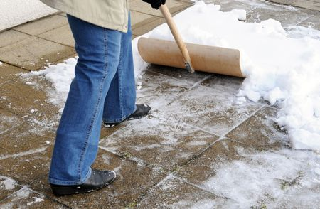 Woman is shovelling snow photo