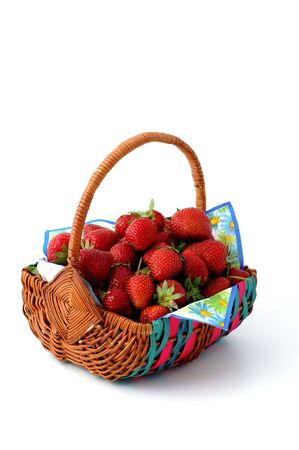 rosoideae: Basket with fresh strawberries on a multicolored napkin Stock Photo