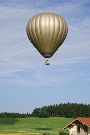 Golden Hot air balloon in blue sky photo
