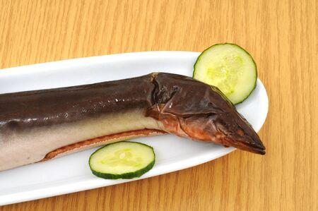 cuke: Freh smoked eel as appetizer Stock Photo