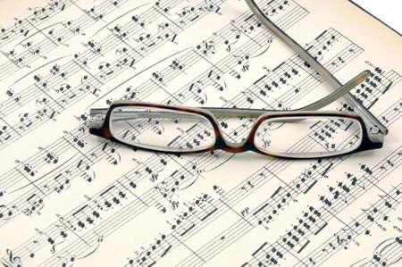 sheet music: Old sheet music in a studio shot