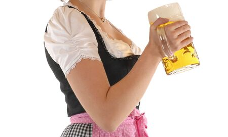 prosit: Young woman with a beer mug, dressed in a Bavarian dirndl Stock Photo