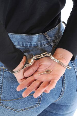 bdsm handcuff: Young woman with handcuffs Stock Photo