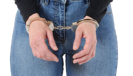 Young woman with handcuffs Stock Photo - 6594110
