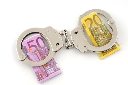Handcuffs with Euro on white background photo