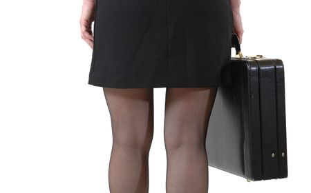 Young slim business woman in mini skirt photo