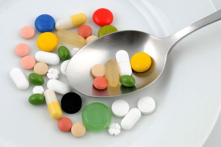 adverse reaction: Some medicine on a white plate Stock Photo