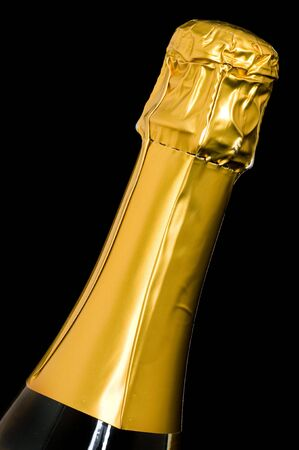 edel: Bottle of champagne in front of a black background