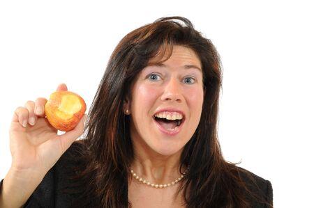 joyfull: Midaged  woman eating an apple isolated on white Stock Photo