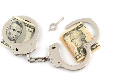 Handcuffs with US-Dollar on white background photo