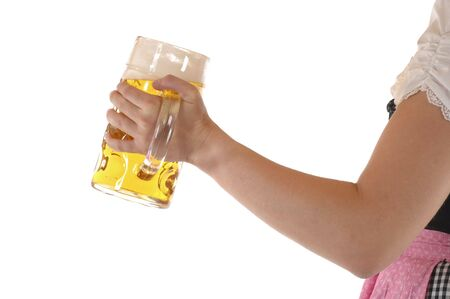 Young woman with a beer mug, dressed in a Bavarian dirndl Stock Photo