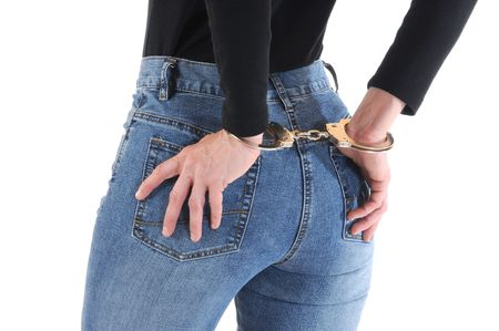Young woman with handcuffs Stock Photo - 6633672