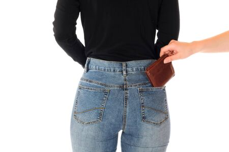 burgler: Rear view of a young slim female in jeans as symbol for the danger of pickpocketing Stock Photo