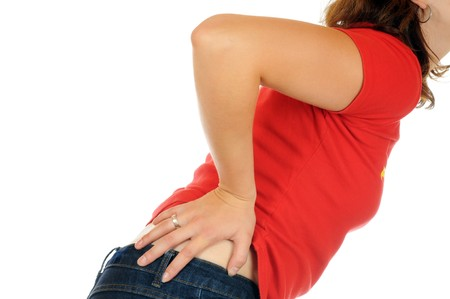Young slim female has backache Stock Photo