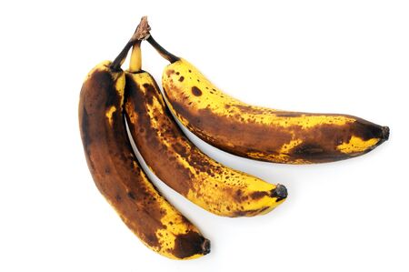 overripe: Overripe bananas in front of a white background