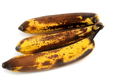 moulder: Overripe bananas in front of a white background