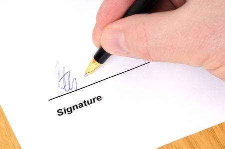 Signing a document with ballpoint pen Stock Photo - 7005873