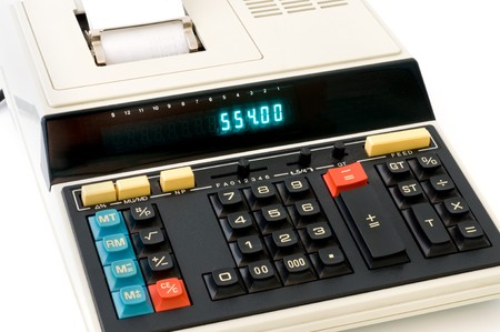 Vintage desktop calculator in front of a white background photo