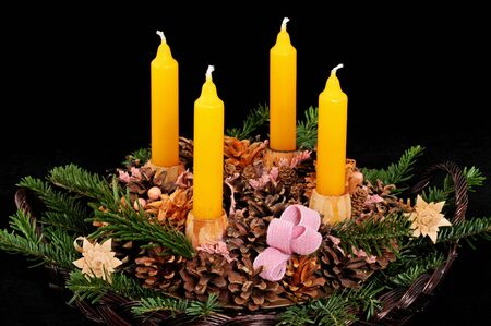 Advent wreath with yellow candles photo