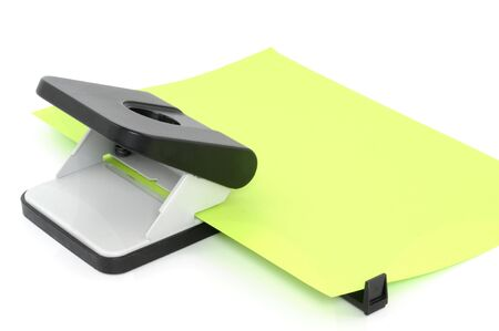 paper puncher: Hole puncher with paper in front of a white background Stock Photo