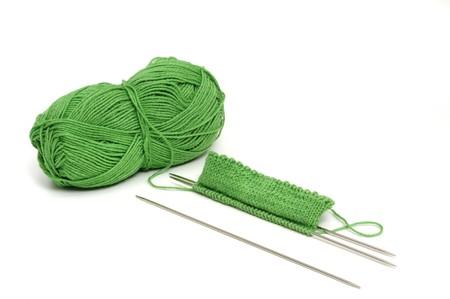 raspy: Green knitting wool on white background