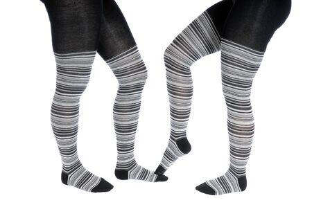 Beine in einer grauen Ringelsrumpfhose  Legs in a grey pattern pantyhose photo