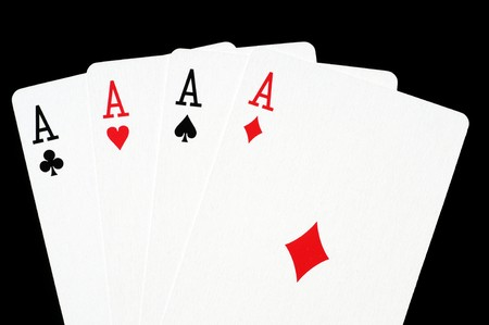 Poker cards in front of a black background photo