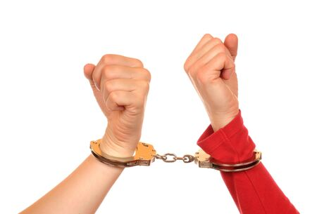 arms of two young women connected with handcuffs Stock Photo - 8097545