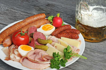 Selection of cold cuts on an old table photo