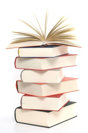 Hardcover books in front of a white background