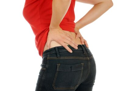 arthritis pain: Young slim female has backache Stock Photo