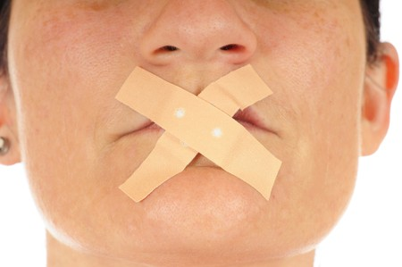 ber: Junge Frau mit einem Pflaster �ber dem Mund  Young woman with an adhesive tape over her mouth