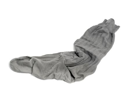 Old grey sock on a white background
