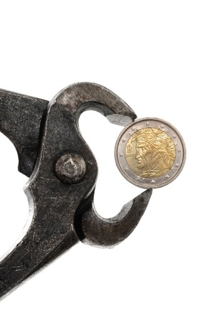 Euro coin in rusty pliers as symbol for the fincancial problems of some countries Stock Photo - 8258675