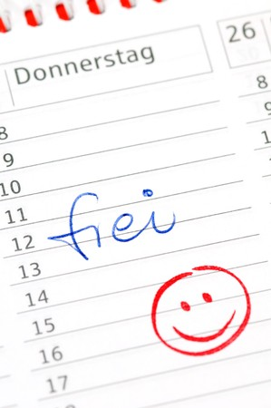frei: Calender with appointment and smiley for a free day (frei)