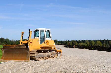 grader: Road construction with yellow grader