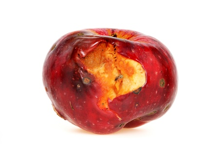 Worm-eaten apple in front of a white background Stock Photo - 8668399