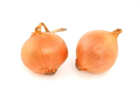 bisected: Onions in front of a white background Stock Photo