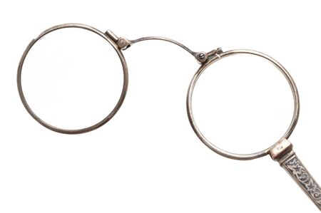 monocle: Antique eyeglasses in front of a white background Stock Photo