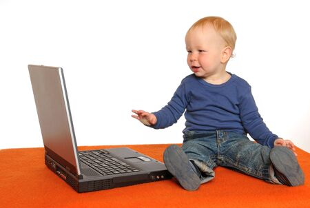 One year old boy with laptop photo
