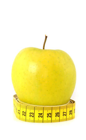 Apple and tape measure as symbol for healthy lifestyle photo
