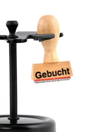 Ruber stamp in an office, gebucht means booked