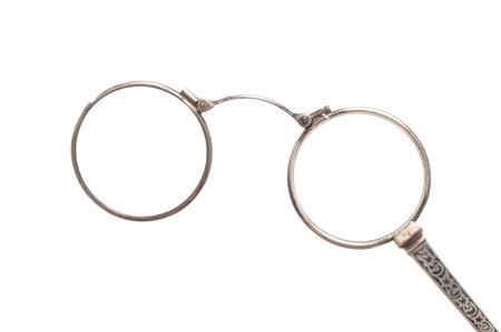 Antique eyeglasses in front of a white background Standard-Bild