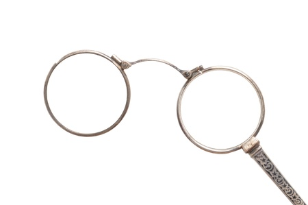 Antique eyeglasses in front of a white background Stock Photo